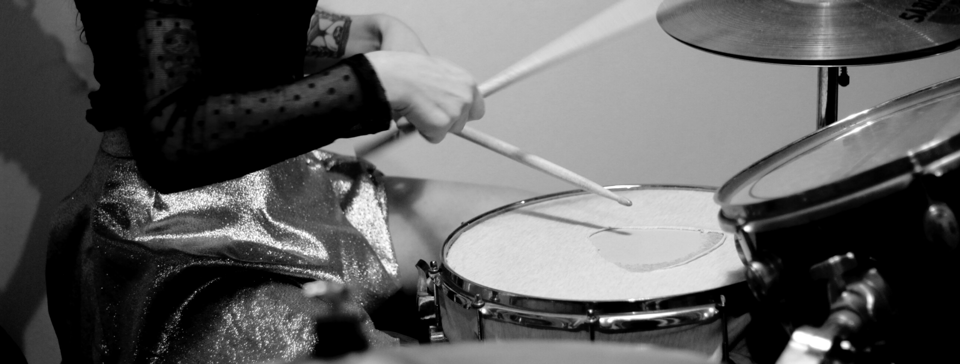 person hitting a snare drum